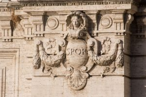SPQR Ancient Roman signature of government meaning the Senate and the People of Rome, bridge abutment over the Tiber