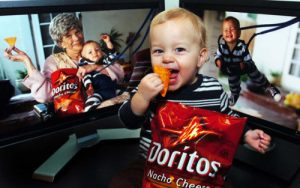 "El Segundo residents Justin and Jill Folk created a commercial for the Doritos Crash Super Bowl contest that features their 15-month-old baby, Jonah. Their submission, ""Sling Baby"", has been named one of the five finalists out of over 6,000 entries. The contest is now in the public voting stage, and the commercial with the most votes will air during the Super Bowl -- with a chance to win $1 million. Jonah flashes a million-dollar smile as he takes a bite of one of his now-favorite snacks."